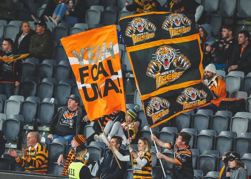 Big cheers: Fans celebrate their team in the crowd. Wests Tigers will again play three home games at Campbelltown in 2021. Picture: Wests Tigers