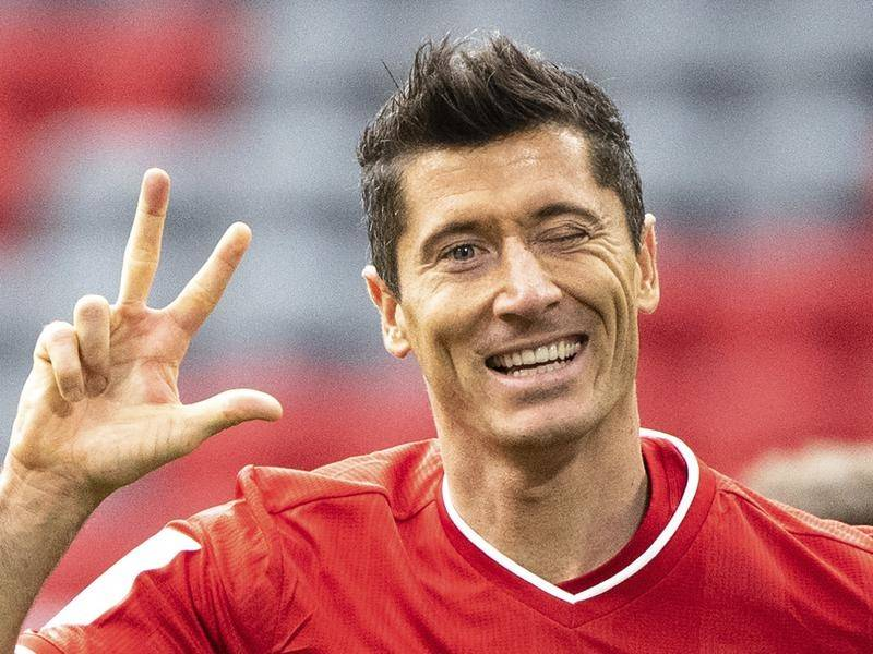 Bayern Munich's Robert Lewandowski celebrates his hat-trick goal in the 5-0 thrashing of Frankfurt.
